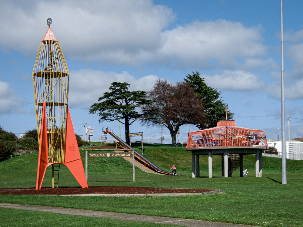 Space park play equipment including a rocket and a flying saucer with the slides removed