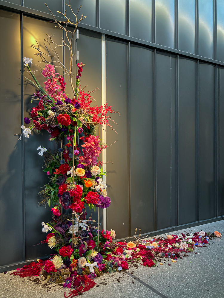 A floral display in an arts centre foyer