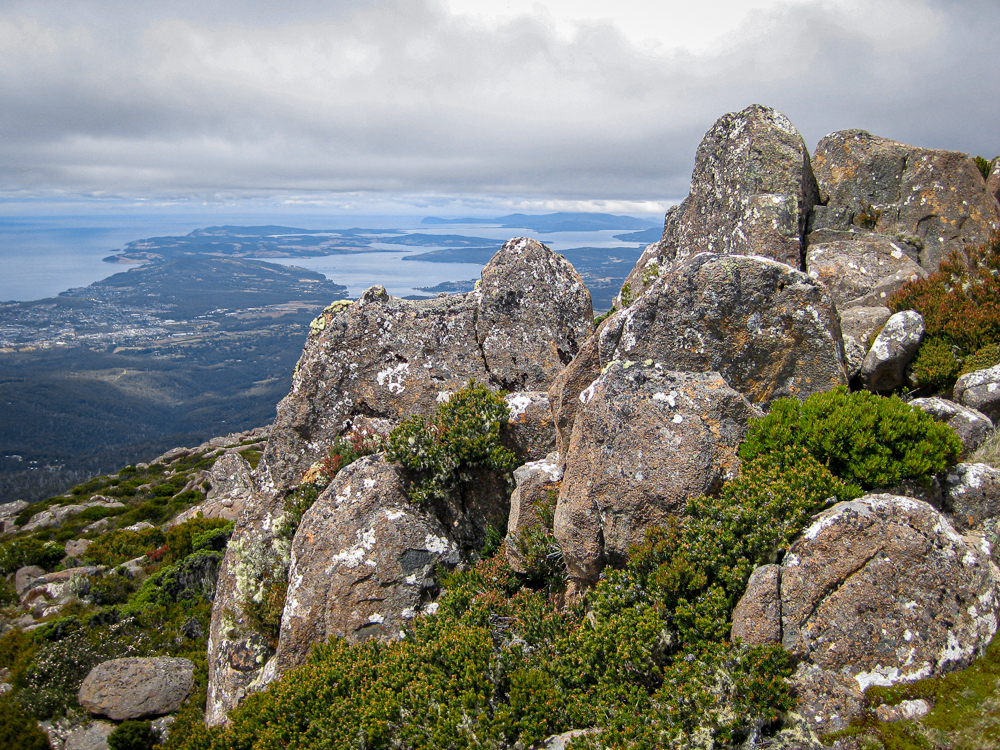 rock formation on the kunanyio/Mt Wellington summit with Hobart city in the background