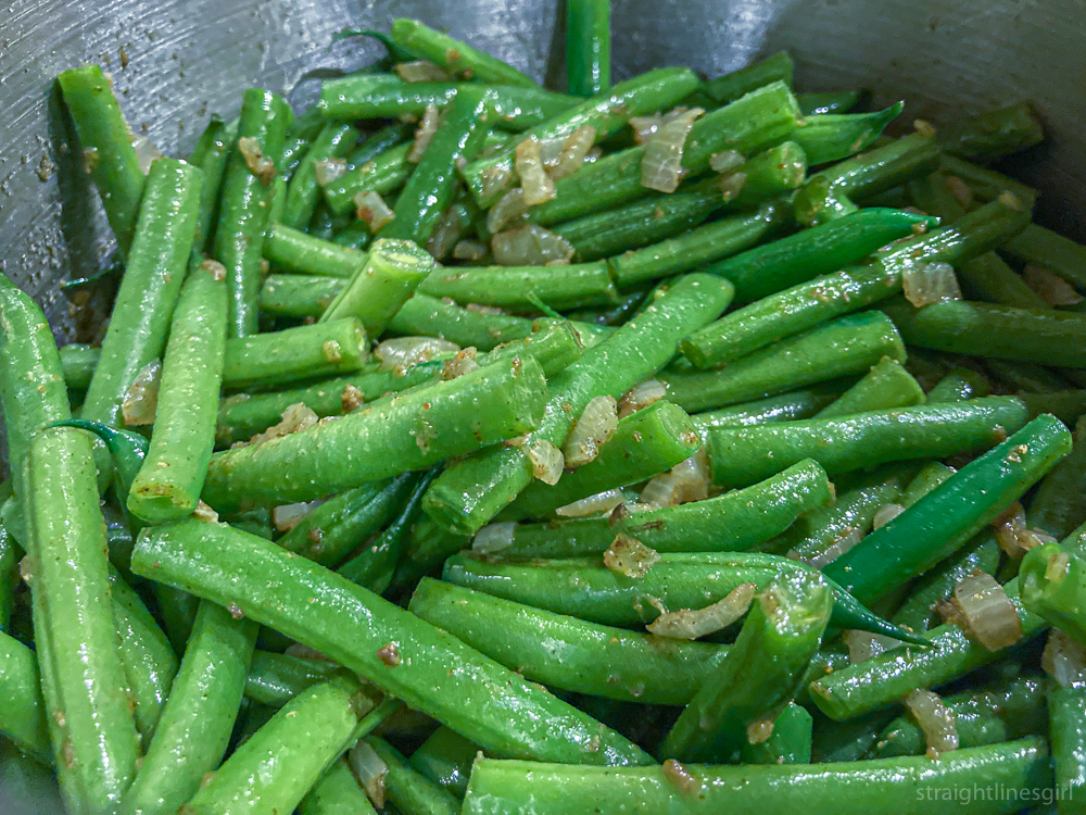 Green beans cooking with onion and garlic