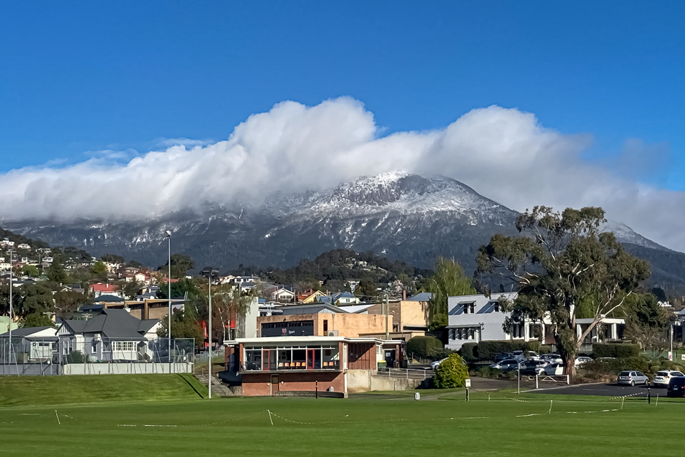snow-topped kunanyi as seen from the sports fields of the University of Tasmania Sandy Bay campus